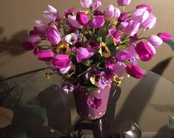 Yellow pansies with mauve/pink flowers in mauve container.