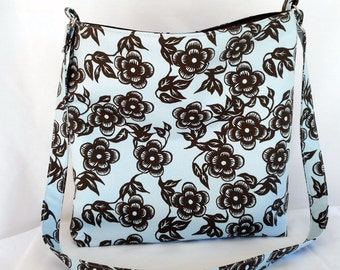 A large brown and blue floral hobo bag with adjustable strap. Handmade by RiverPurseWorks