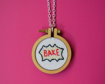 "Embroidered necklace of ""bake"" in comic book style"