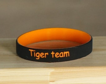 Custom silicone bracelet. Personalized silicone wristbands. Sport team, business team