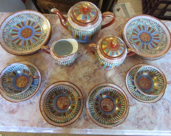 Vintage Thousand Faces Japanese Tea Set.  Like new condition, hand painted, paper thin tea cups.  Purchased in Seattle between 1927 and 1932
