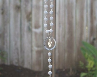Rosary style beaded necklace