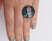 Blue Haired Girl Holding a Doll Ring by Ugly Shyla