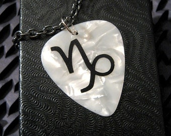 Capricorn sign guitar pick necklace, white & black, hot foil stamped