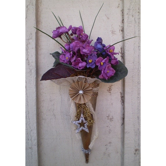 Victorian style paper cone violets door wall hanging floral arrangement February flowers