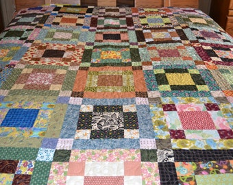 Beautiful scrappy quilt ,queen sized