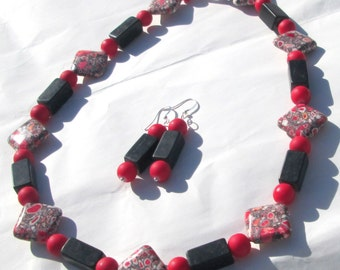Red black white and orange speck mosaic stone with black stones and red acrylic bead necklace and earrings hand made set