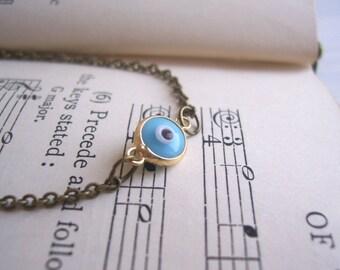 SALE Petite Evil Eye charm bracelet - sky blue protective small charm on golden brass - boho jewellery