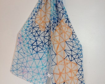hand dyed silk scarf in blue and orange triangle web