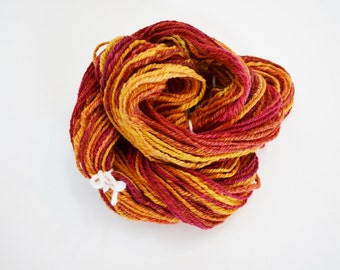 Handspun Yarn in Bright Autumn Colors - Self Striping Chain Ply 3 Ply Handspun Yarn in Merino, Bamboo, Silk. Rust orange, deep red, yellow.