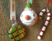 Set of Three Christmas Folk Art Ornaments Snowman Candy Cane Plaid in white red and green