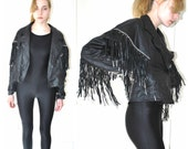 dripping with fringe boho 1970s rock and roll black leather moto jacket medium