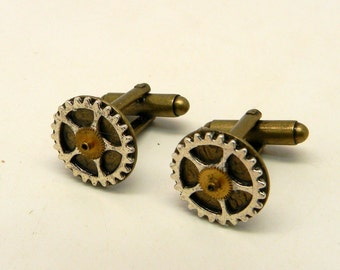 Steampunk jewelry cuff links with gears.