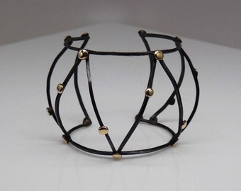 Sterling silver, oxidized birdcage cuff with brass balls, statement