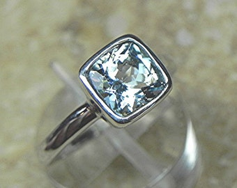 Hand Made Cushion Cut Natural Aquamarine 7x7mm  1.20 carats in a 14K White gold Engagement ring.