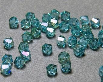 Swarovski Aquamarine Champagne Coated 4mm Faceted Crystal Bicone Beads (24)