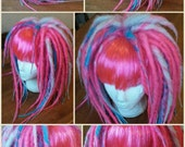 Full a line wig, neon pink, bleach blonde and turquoise.