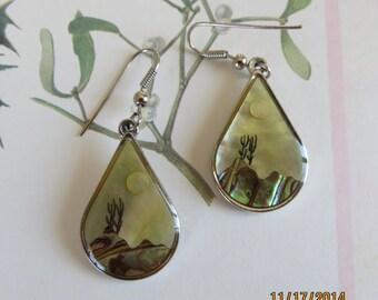 Teadrop silver tone earrings landscape designed in shell.