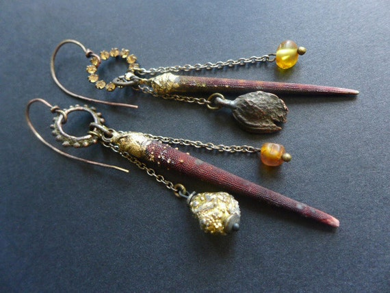 Halcyon. Rustic assemblage asymmetrical earrings with sea urchin spines and Baltic amber bits.