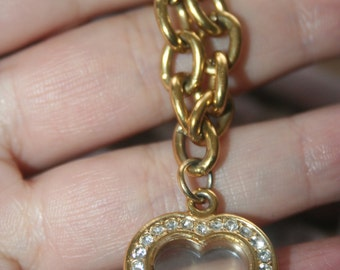 SELL OUT  ...Vintage Gold tone with Charm in Shape of heart  Bracelet  Marked Avon  Stunning
