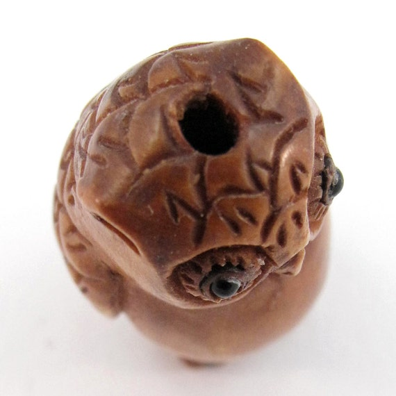 Wise owl hand carved boxwood ojime bead from