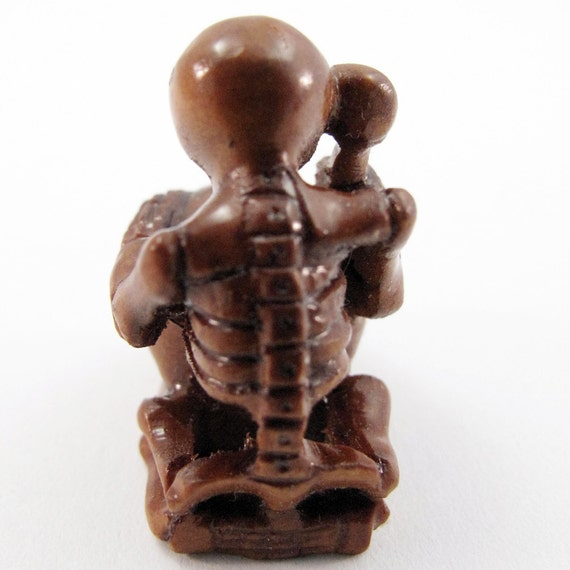 Skeleton playing the druml hand carved boxwood ojime bead
