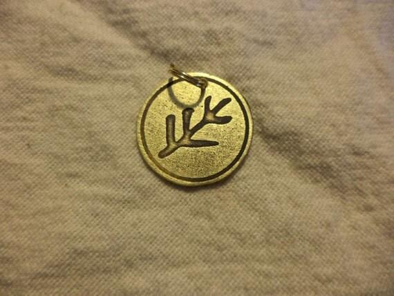 etched brass elder rune charm