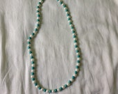 Single stran turquoise cowgirl necklace with pearls