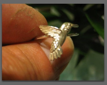 Humming bird sterling ring , And i have them in all sizes .