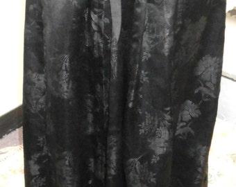 "1900, 30"" waist, black Chinese flowered embossed silk skirt."