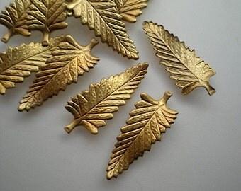 12 brass leaf charms, No. 7