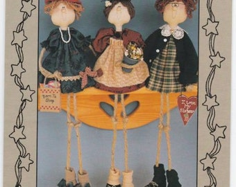 Sweet Dreams Doll pattern #216 is a depiction of  3 Shelf Sitter Sisters. They finish at 19 inches tall.