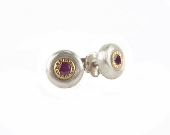 silver studs with rubies enchased in structured gold