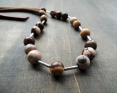 Mookaite round beads combined with silver tubes and chocolate brown crochet