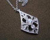 Diamond shaped silver & rhinestone vintage pendant necklace LITES by Sarah Coventry