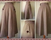 Swell Dame 1950s skirt with buttton detailed side pockets and center pleat