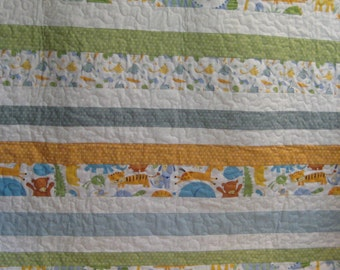 Baby Quilt with Dinosaurs and Polka Dots with blues and greens and yellows,baby quilt, baby gift, boys blanket,boys quilt,baby shower gift