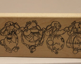 Four Bunny boys and girls Rabbits Dancing Rubber Stamp