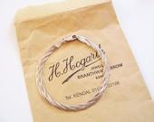 Sterling braid bracelet: Sweet, hallmarked sterling silver braided strands 1960s costume statement bracelet by Hogarths of Kendal