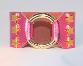 Gold Star Studded Ring Clasp Cuff on Pink Metallic Leather support your favorite team by Rockin its Colors