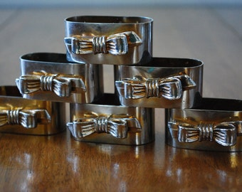 six silver plated napkin rings with goldtone bows - cottage chic