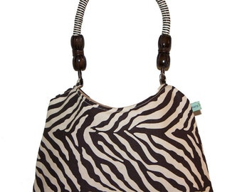 Exotic zebra day to night handbag with great shape and wood/rope handle