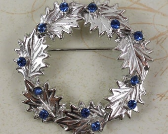 Vintage Dodds Blue Rhinestone Silver Leaf Wreath Circle Brooch