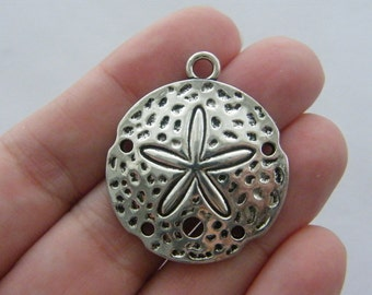 4 Sand dollar pendants antique silver tone FF220