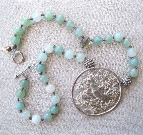 Soft Spoken - Hand knotted adventurine with vintage bird pendant - assemblage jewelry