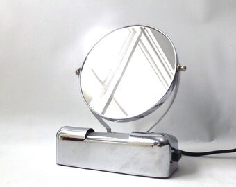 vintage 1950's lighted makeup mirror vanity chrome magnifying bathroom electric outlet mid century modern retro decorative home decor round