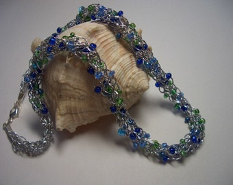 Ocean dream, silver necklace, made in Nova Scotia, sea glass like, blue, green glass beads, royal blue, light green, hand knit, seed beads