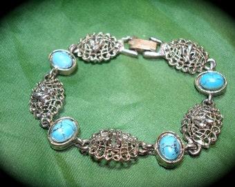 1969 Turquoise Like Cabochon and Fleur de Lis Bracelet.