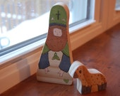 St. Patrick and sheep (wooden saint figure with wood sheep)