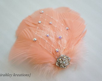 MAYLEA -- Peach Feather Fascinator Wedding Bridal Bride Headpiece Prom Hair Clip with Iridescent Rhinestones and Ivory Birdcage Veiling